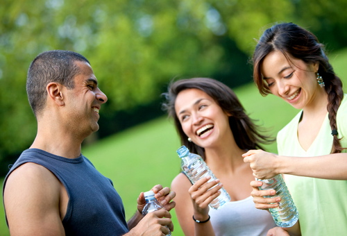people holding bottles of water outdoors
